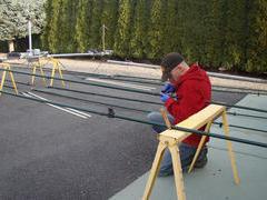 Grandson Chase assembling SteppIR DB18E